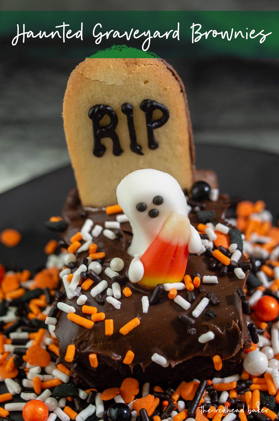 A close-up of a haunted graveyard brownie with orange, black and white sprinkles on a black plate