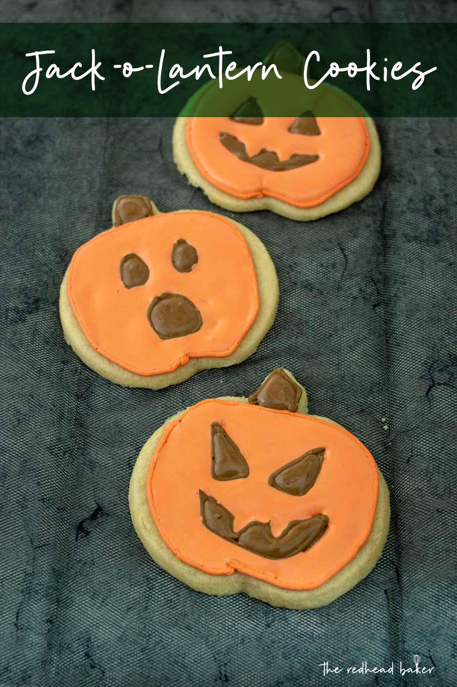 Three jack-o-lantern cookies