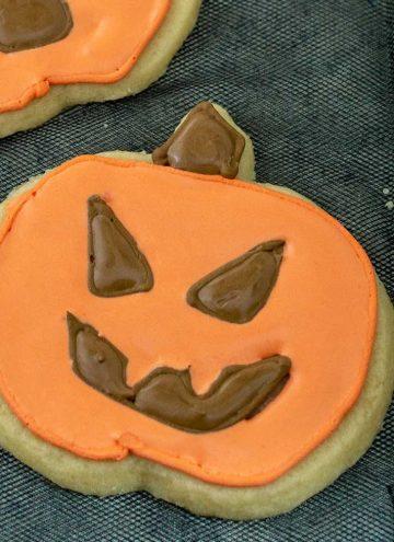 A close-up on a jack-o-lantern cookie