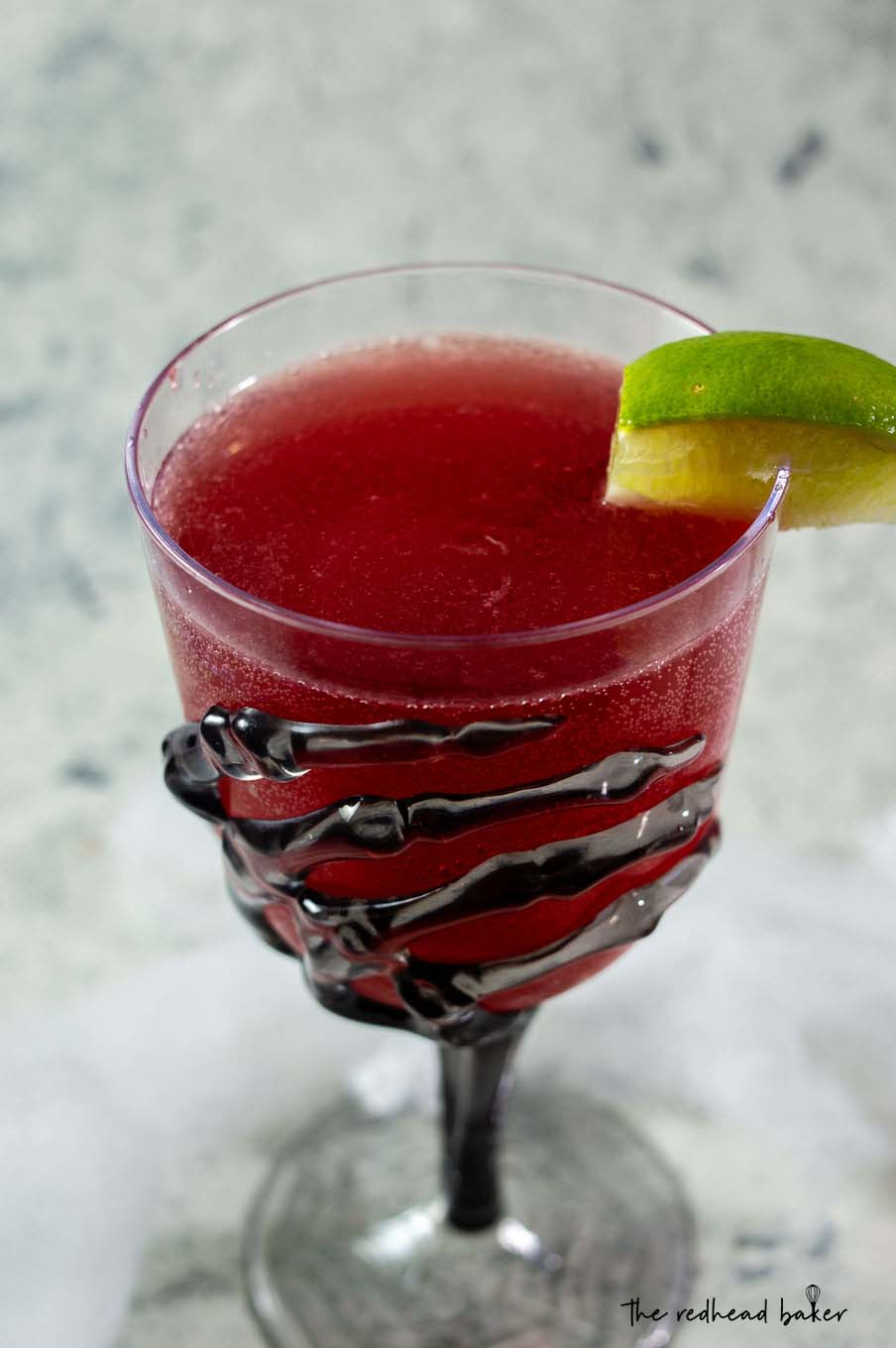A close-up of a glass of pomegranate margarita