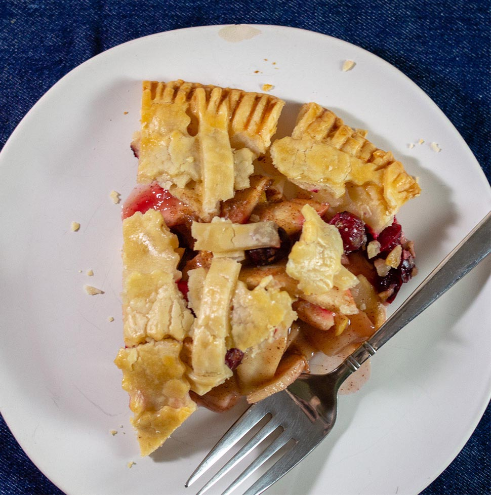 A slice of cranberry apple pie