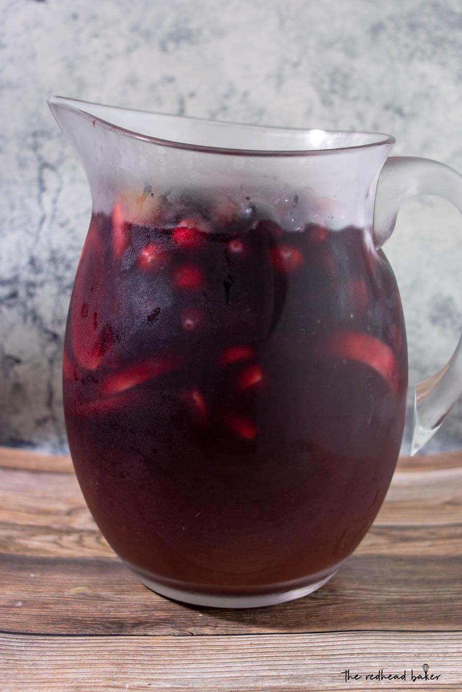 A pitcher of cranberry apple sangria