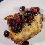 Cranberry balsamic chicken thighs on a plate