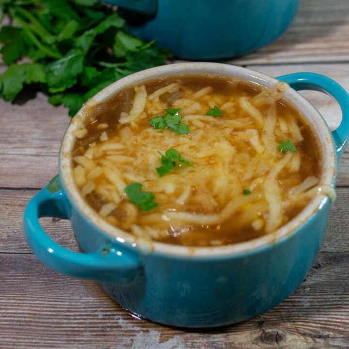 A close-up of a cocotte of French Onion Soup