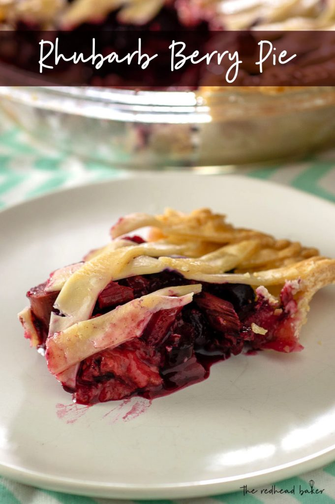 A slice of rhubarb berry pie on a plate