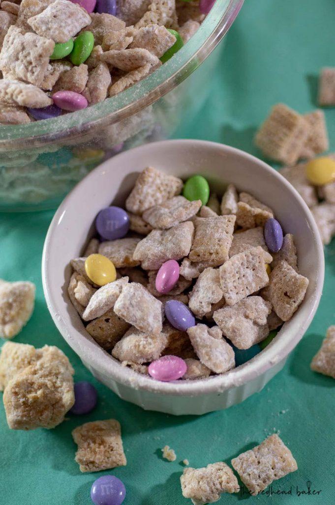 A ramekin of Easter muddy buddies (aka Bunny Bait) next to a larger bowlful