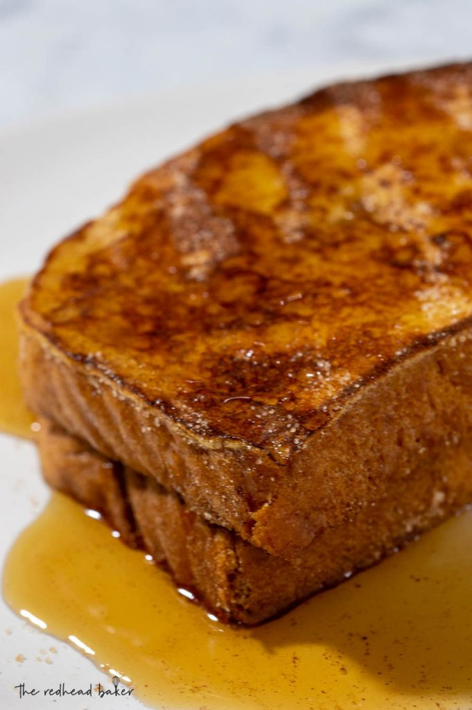 A close-up of two slices of churro French toast
