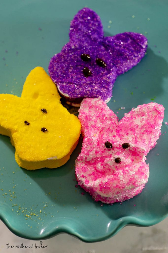 One yellow, one purple and one pink marshmallow bunny