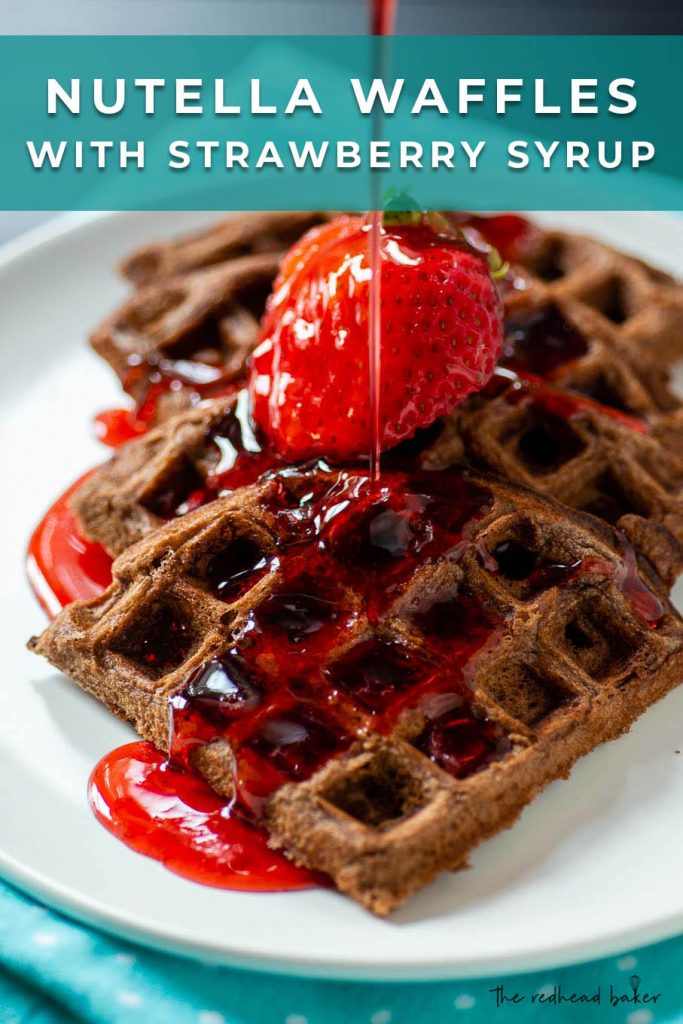 Nutella waffle wedges topped with a fanned strawberry and strawberry syrup