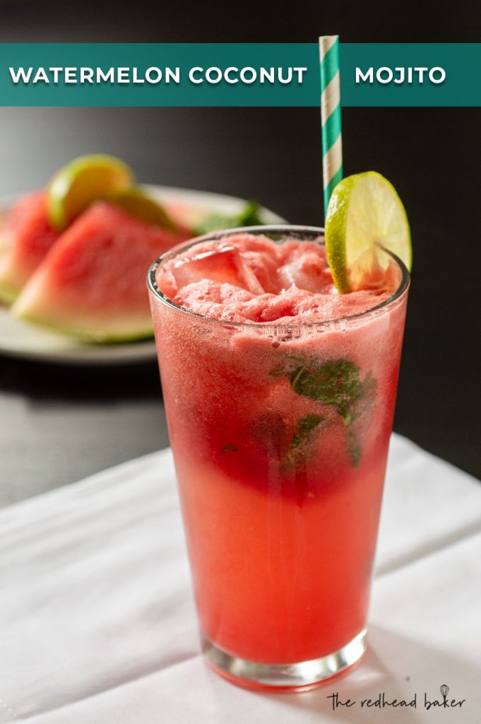 A glass of watermelon coconut mojito garnished with a lime slice