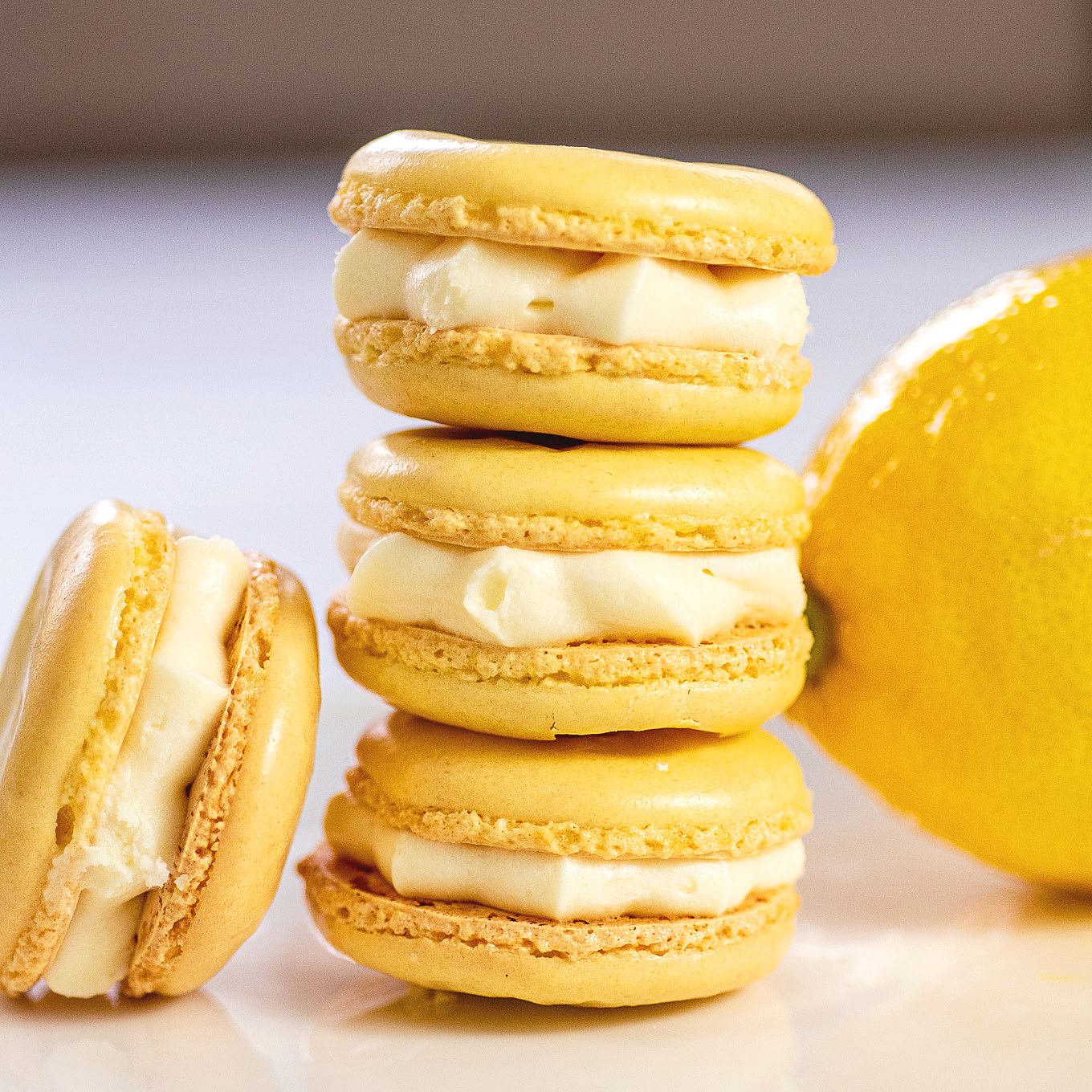 A stack of three lemon macarons