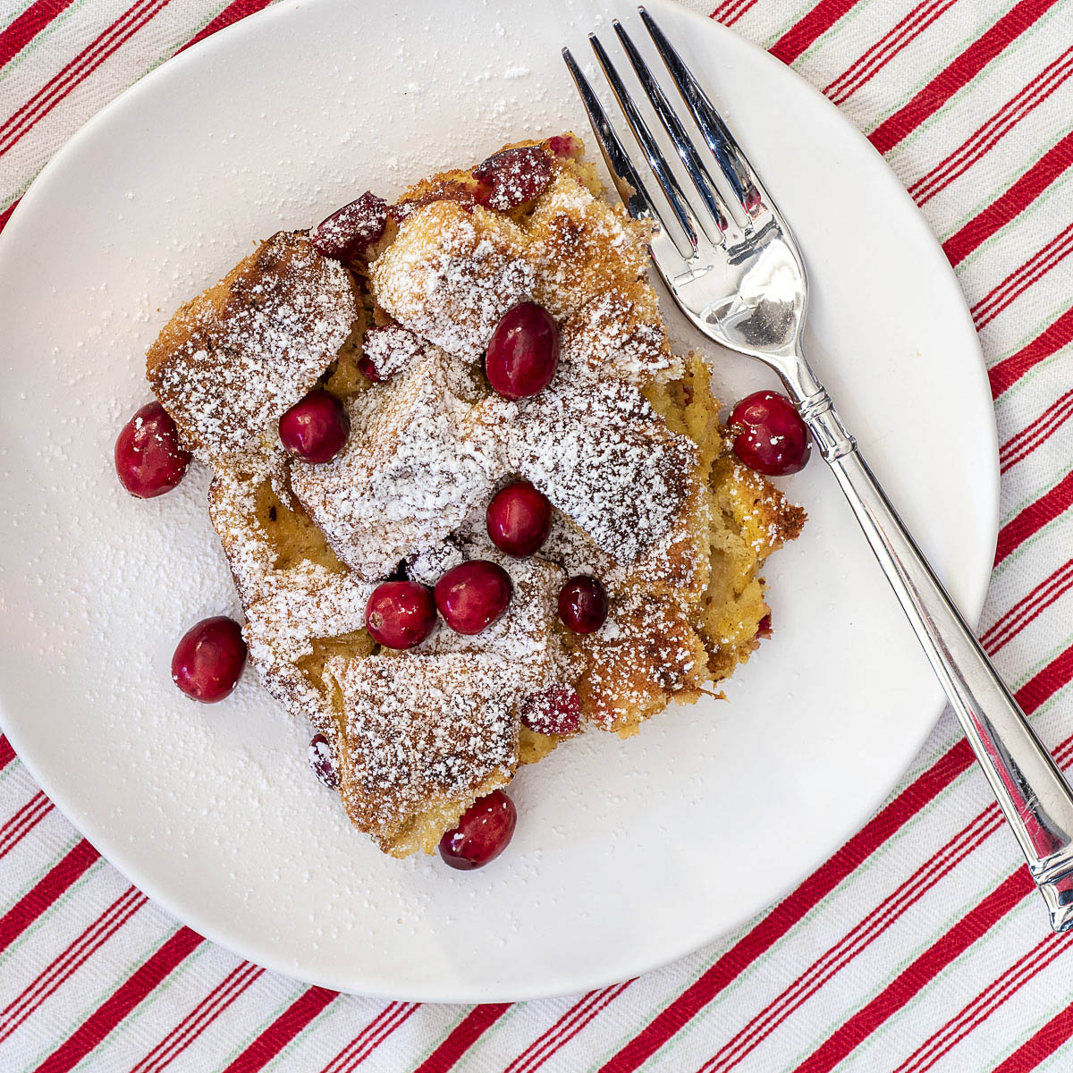 A dish of Cranberry Eggnog French Toast Bake