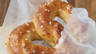 Soft pretzel wrapped in wax paper
