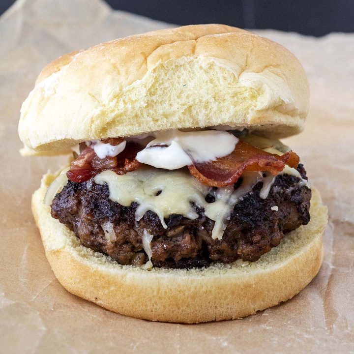 An Irish style burger on a crumpled piece of parchment paper