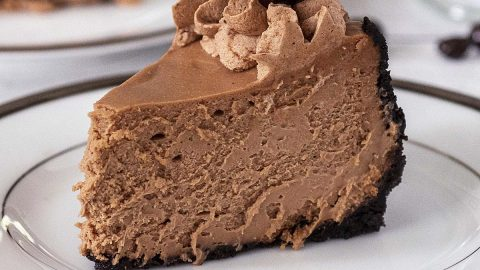 A slice of mocha cheesecake on a white plate