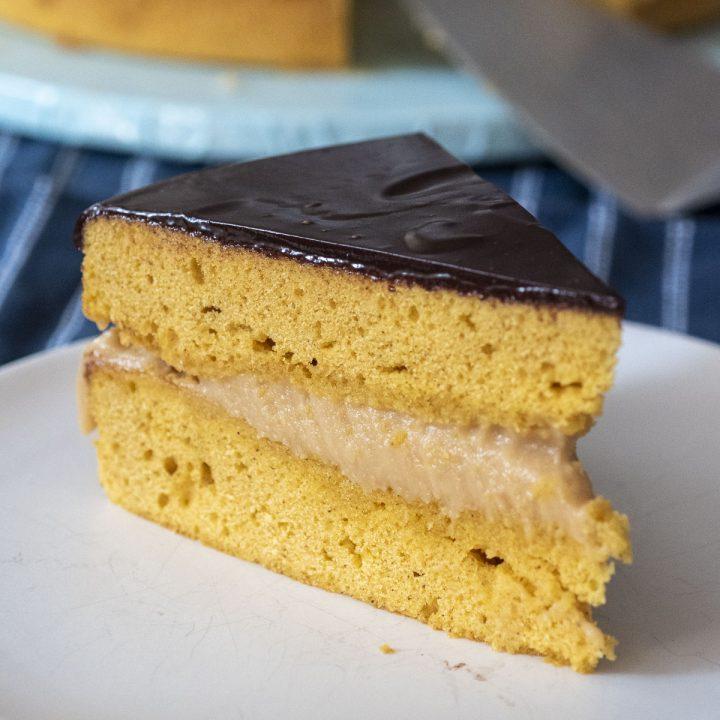 A slice of Pumpkin Boston Cream Pie.