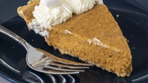 A slice of pumpkin marshmallow pie on a blue plate.