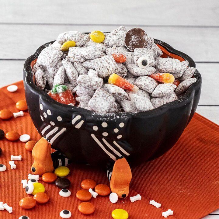 Halloween Muddy Buddies in a cauldron candy dish.