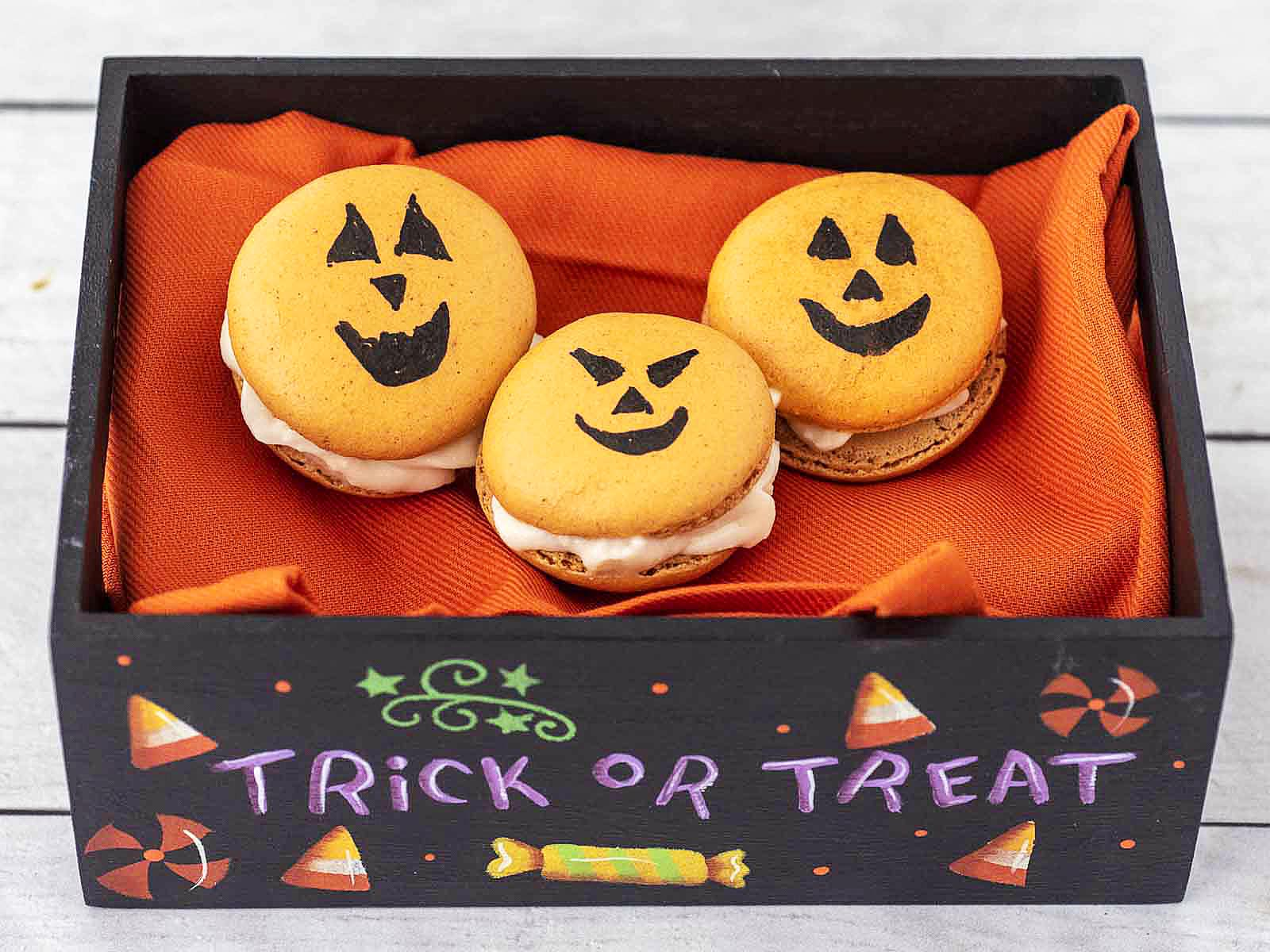 Three Halloween Macarons in a hand-painted Trick or Treat box.