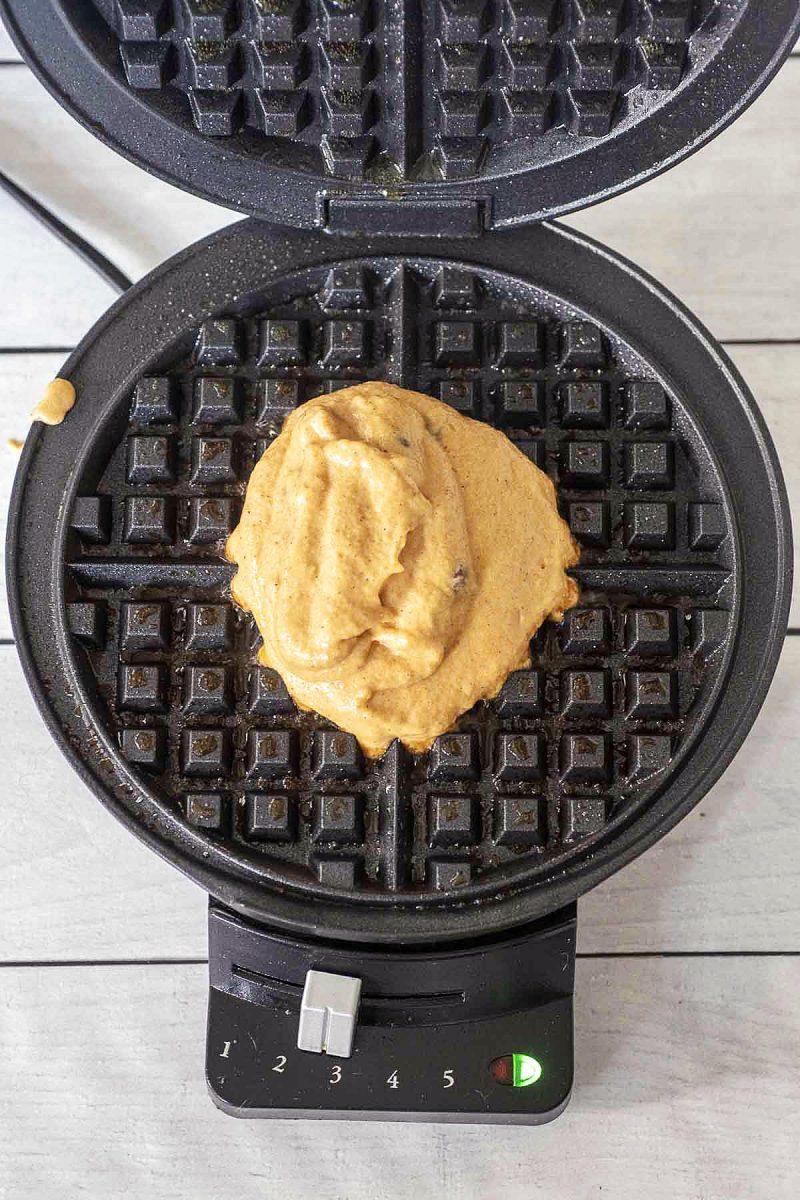 Pumpkin waffle batter in a pre-heated waffle iron.